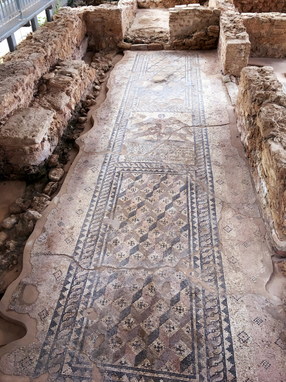 It's remarkable that these tiled floors survived for so long, considering there is evidence of two fires and antiquities thieves over the centuries!