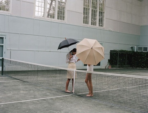 Umbrellas on tennis court