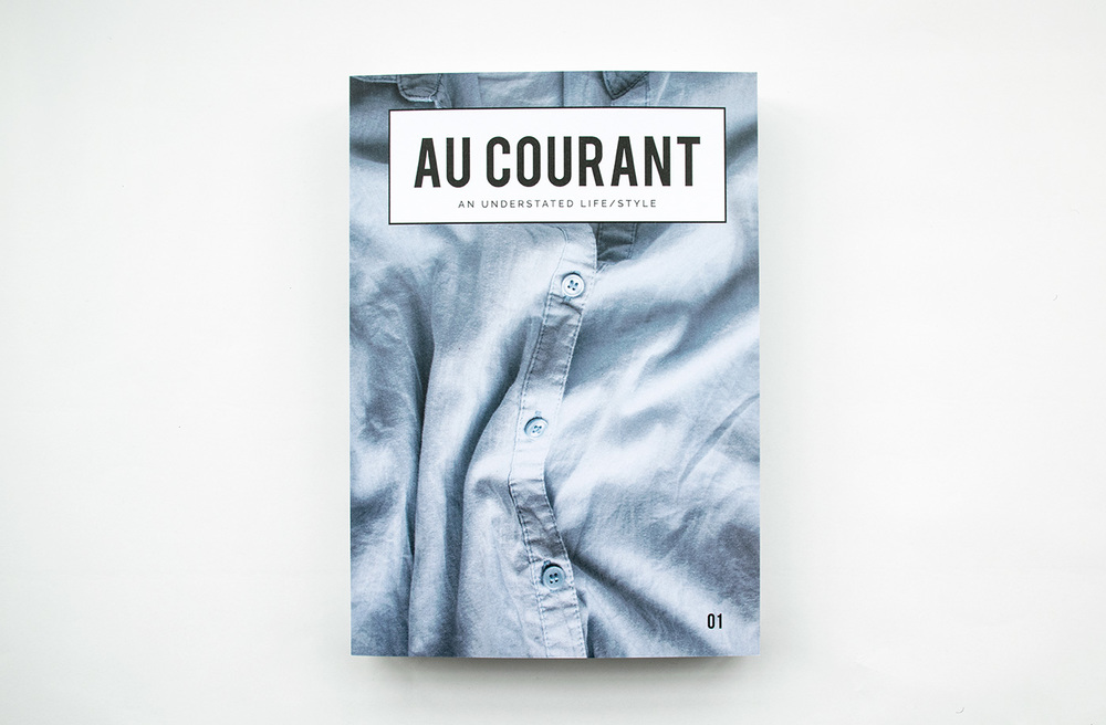 The cover of Au Courant Volume 01—a close-up shot of a crumpled shirt, an understated image synonymous with Lisa-Marie's vision.