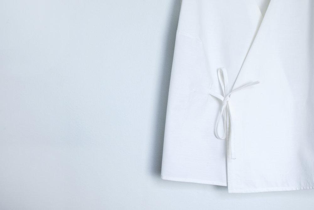 Close up of a organic cotton wrap top