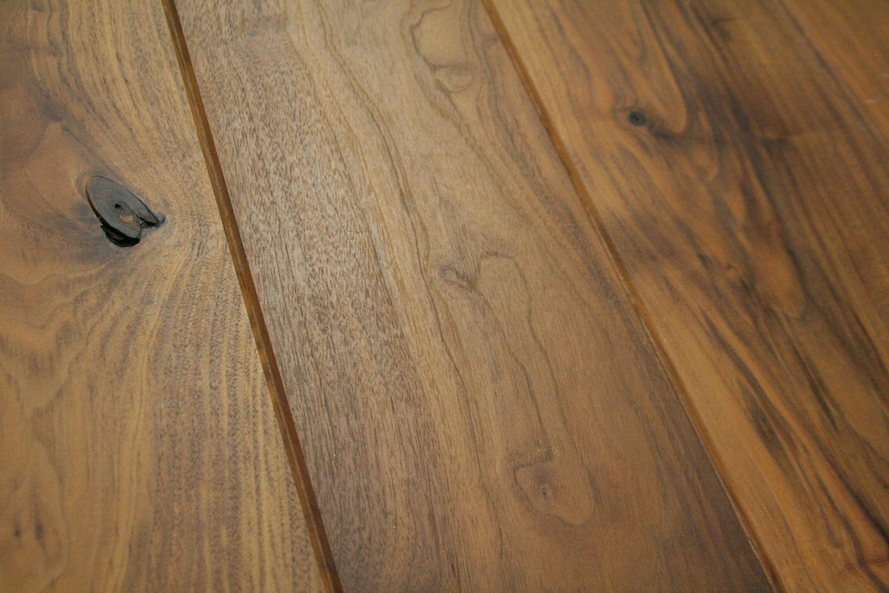 Walnut wide plank V-groove.