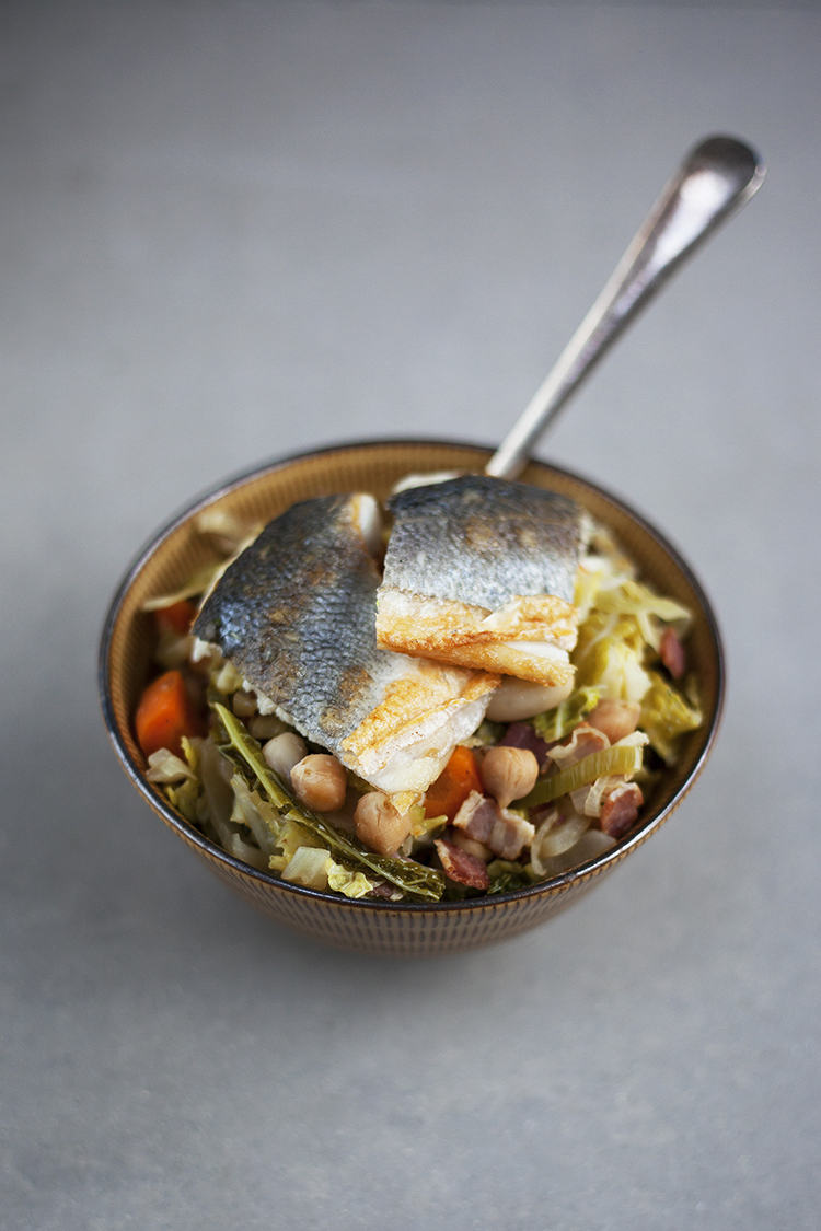 Cabbage and white bean stew with sea bass