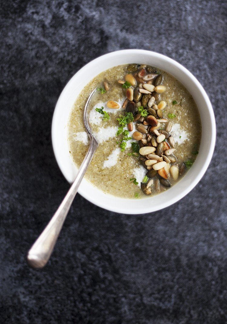 Broccoli soup with crunchy seed and nut topping