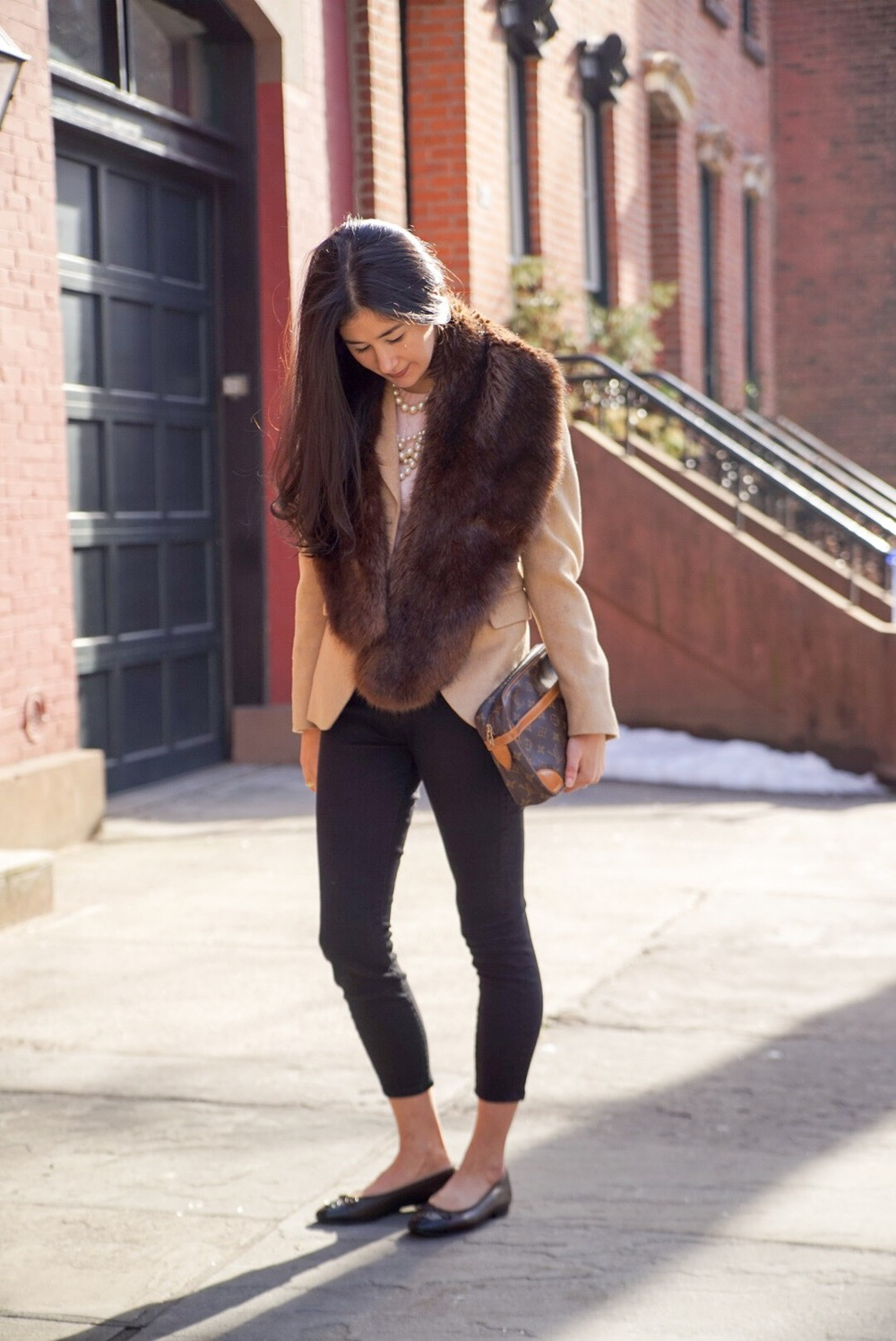 Brooks Brothers Camel Blazer Zara Faux Fur Stole J Crew Cashmere Sweater J Crew Multi-Strand Pearls LOFT Black Skinny Jeans Louis Vuitton Clutch Chanel Ballet Flats