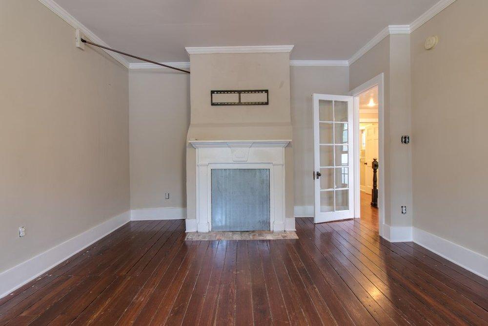 charleston_single_house_master_bedroom_brick_fireplace.jpg