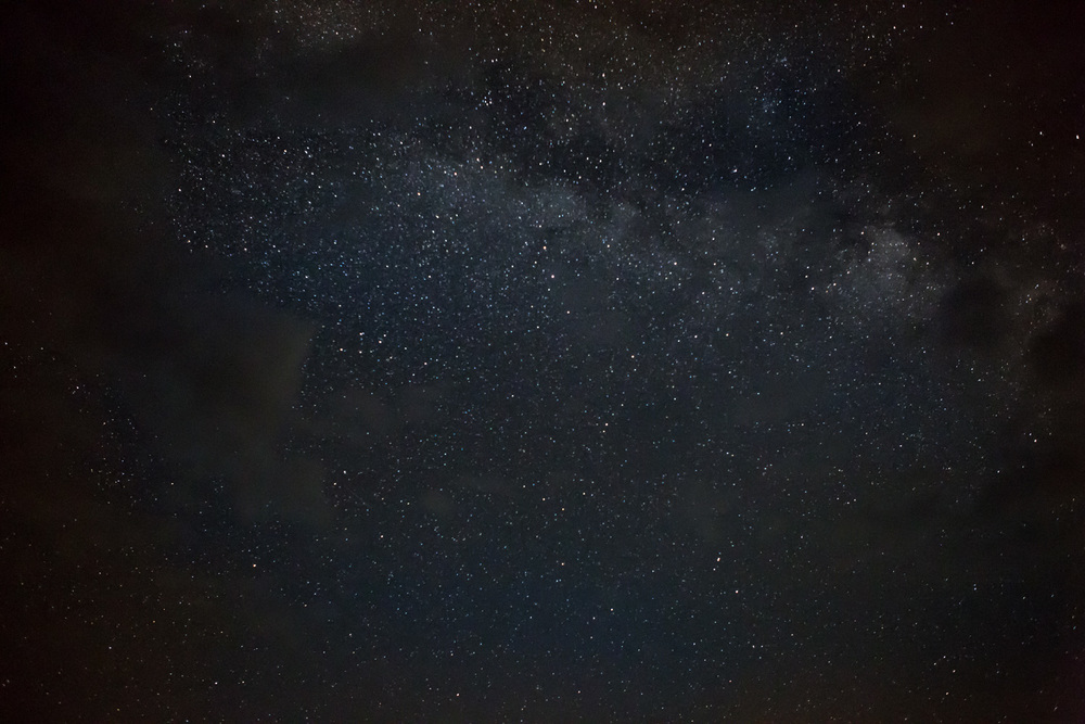 This is a shot straight up where you can see the galaxy through the clouds. I did this because I was looking for a way to minize the light pollution in the image.