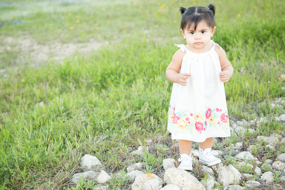 We were actually done with photo shoot and were just gabbing waiting for my family to arrive for  their bluebonnet photos . This little one enjoyed running around in the grass, trees and rocks.