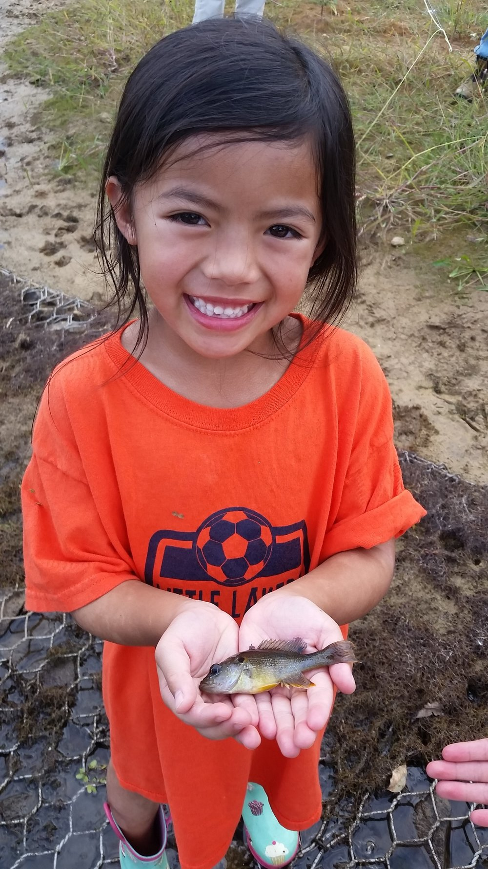 The smile tells it all .... first fish on her own hand tied fly.