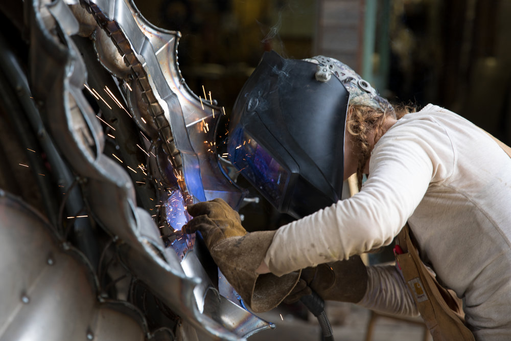 Kate Tupper welds portal frames into Heavenly Bodies A.K.A MAF Unit 0 Photo: Lee Orr