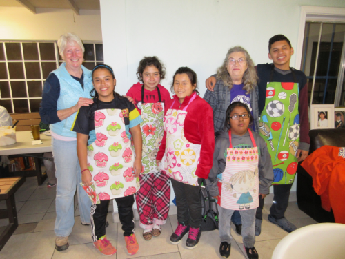 The children of St. Joseph's Home proudly modeled the aprons they each had made under the guidance of Kathy Levin and Frieda Jackson, two of the Capstone Mission volunteers. From left to right: Kathy Levin, Esther, Natalia, Lupita, Angie (front), Freida Jackson (rear), and Victor.
