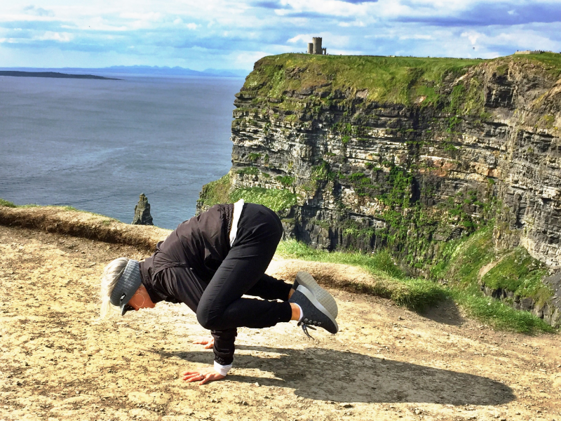 Crow pose at the Cliffs of Moher, Ireland