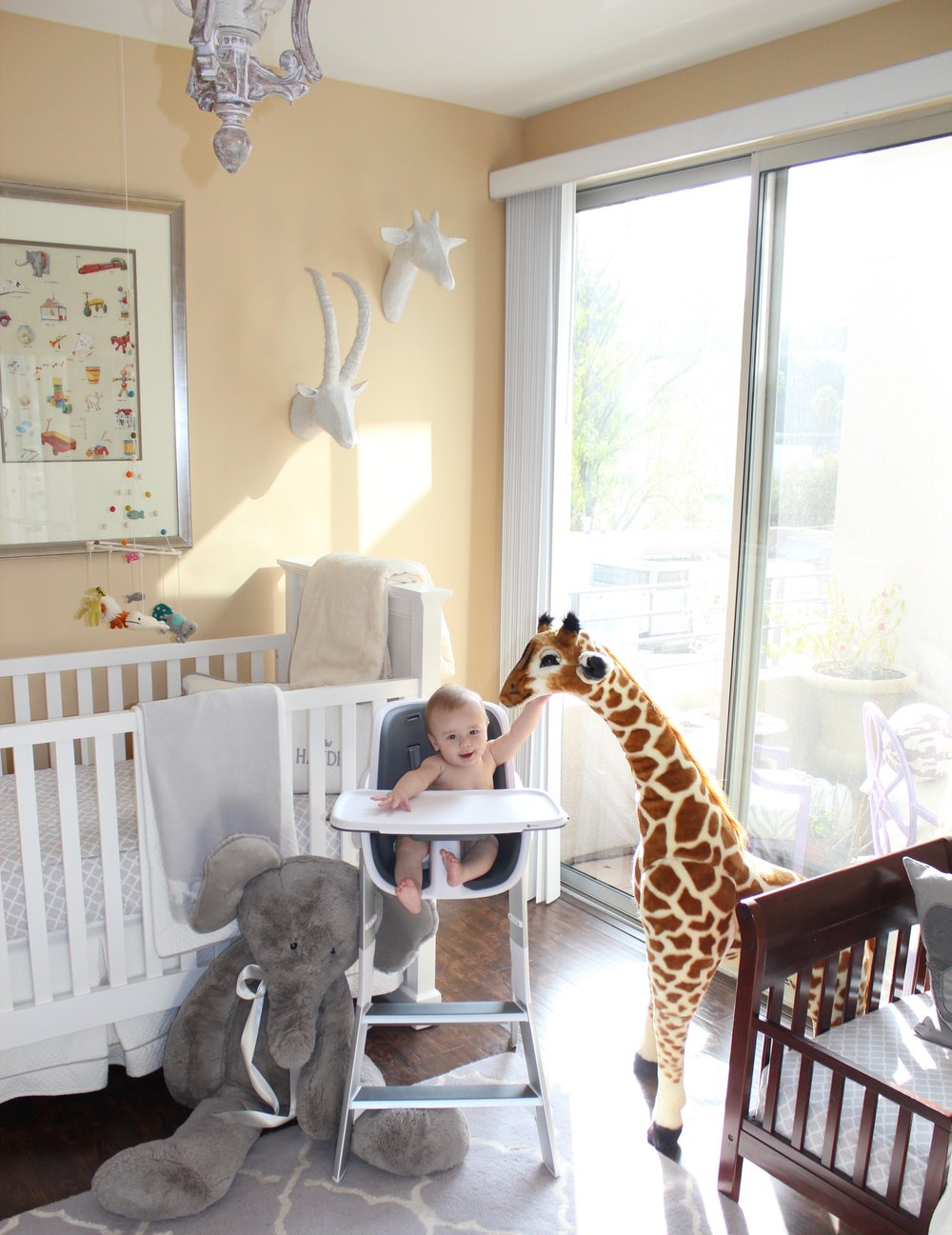 "When I need to clean up the boys' room, sometimes I bring his   4Moms highchair   in there and let him commiserate with his ""friends!"" He loves being more eye level with   the giraffe  . And he loves being higher up in general, so we get a lot of use out of this chair. And I enjoy the sleek look."