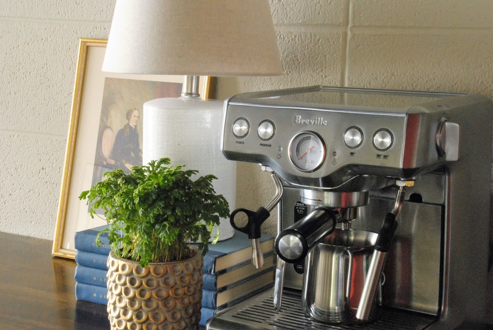 kitchenette with espresso machine art and lamp