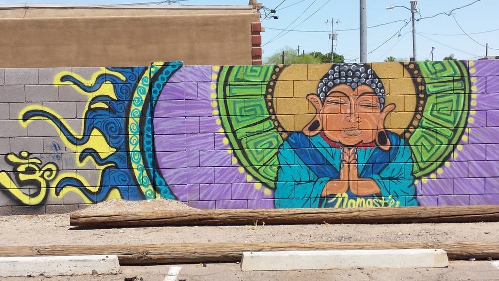 "Ky Thorton and Mel Gee painted this mural, ""Angelic Energy,"" on a wall near the corner of 6th Street and Belmont Avenue."