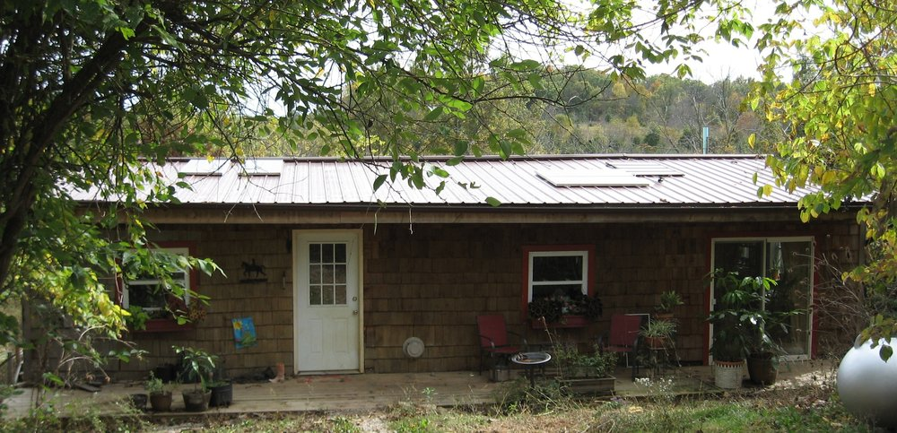 My metal roof supports my solar panels as well as a gutter system which leads to a cistern under the back porch.  Fox Run Environmental Education Center