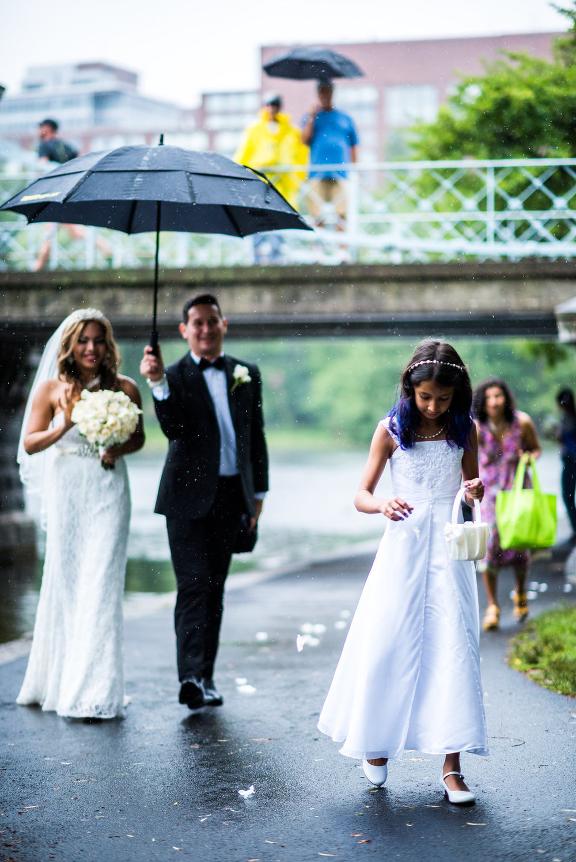 rainy wedding flower girl
