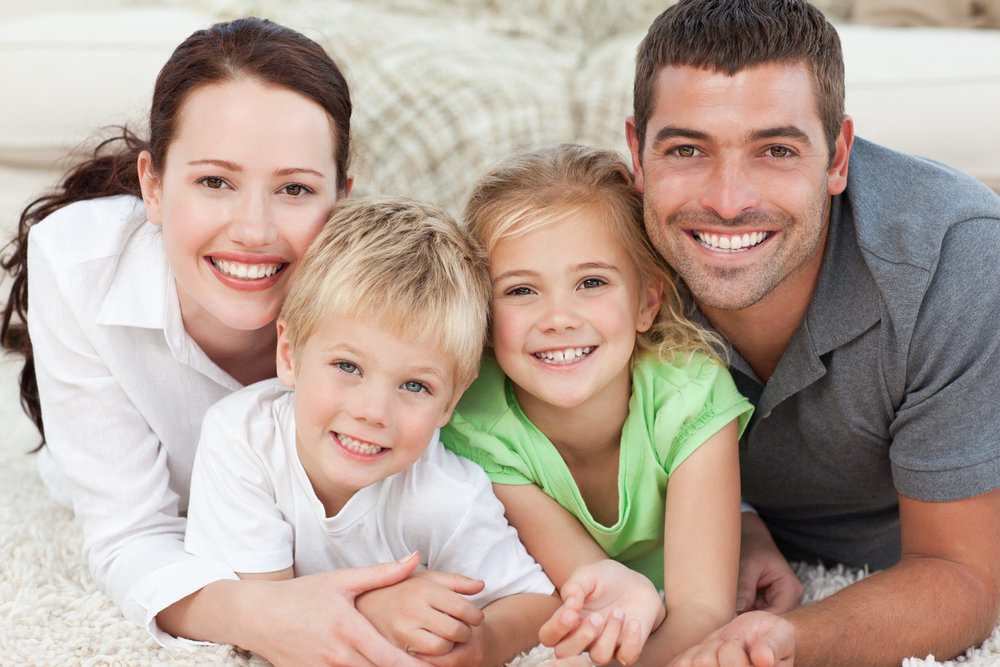 Portrait of a smiling family in the carpet