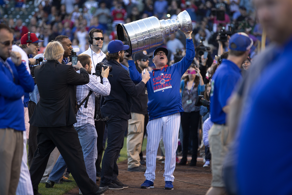 Chicago Cubs manager Joe Maddon raises the Stanley Cup at Wrigley Field on Tuesday, June 16, 2015. (Erin Hooley/Chicago Tribune)