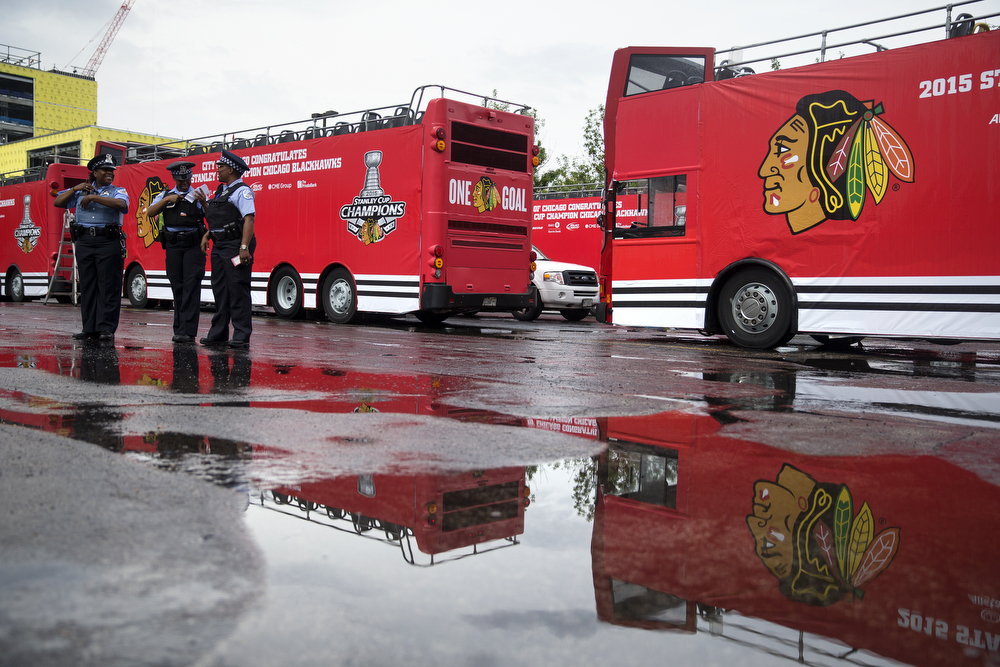 Double-decker buses wait to carry Blackhawks players from the United Center to the championship parade and rally at Soldier Field on June 18, 2015. (Erin Hooley/Chicago Tribune)