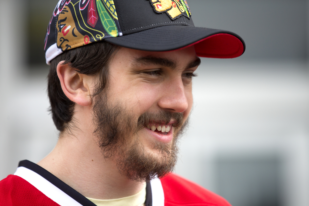 Blackhawks' Trevor van Riemsdyk talks to media before boarding a bus at the United Center in Chicago for the start of the championship parade on June 18, 2015. (Erin Hooley/Chicago Tribune)