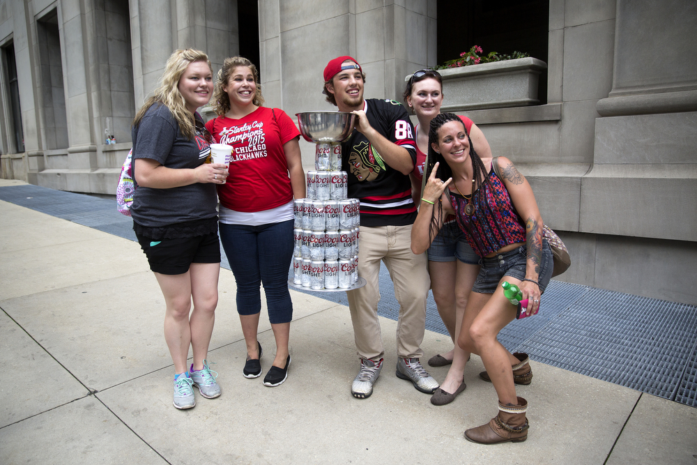 Ryan Boettcher, center, poses with fans and his homemade beer can Stanley Cup outside of Union Station in Chicago Thursday, June 18, 2015. (Erin Hooley/Chicago Tribune)