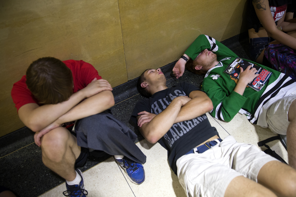 Blackhawks fans rest on the floor of Union Station after the championship parade and rally in Chicago Thursday, June 18, 2015. (Erin Hooley/Chicago Tribune)