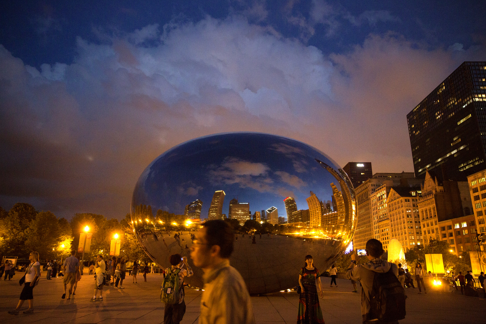 The Bean at night, with people doing what people do at The Bean, as seen in Chicago's Millennium Park Sunday, June 14, 2015. (Erin Hooley/Chicago Tribune)
