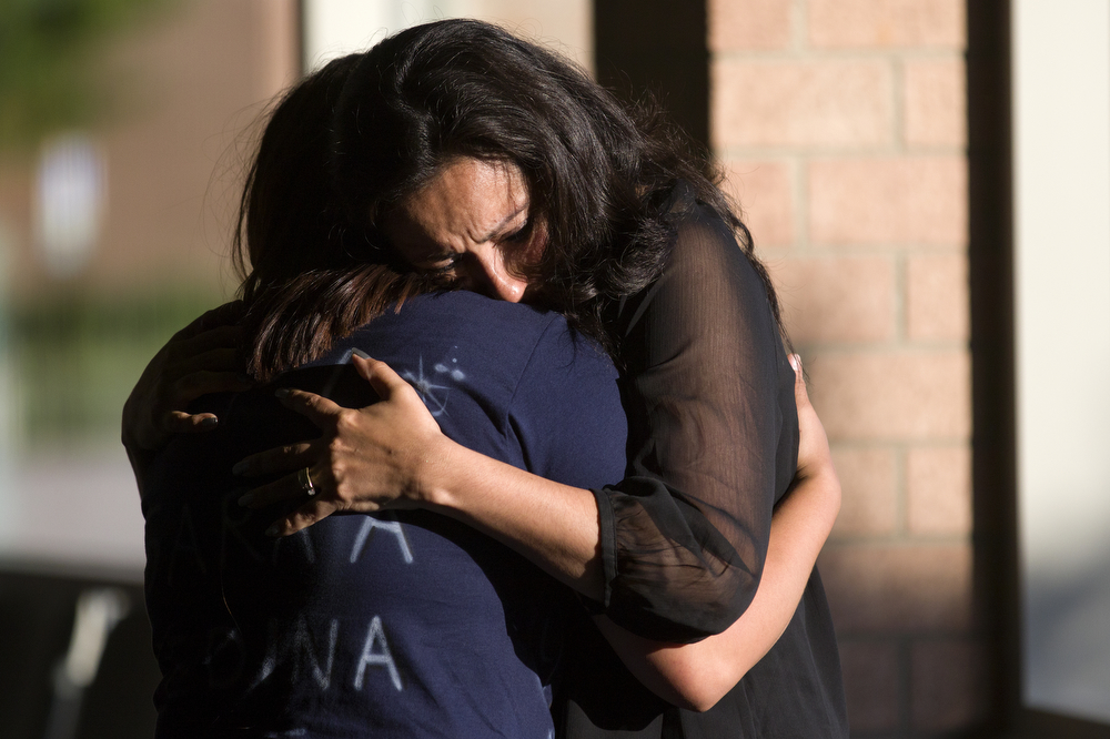 Friends and family embrace before the funeral of U.S. Marine Cpl. Sara Medina, the Aurora woman who died in a helicopter crash during an earthquake relief mission in Nepal, at St. Mary Immaculate Church in Plainfield Wednesday, June 3, 2015. (Erin Hooley/Chicago Tribune)