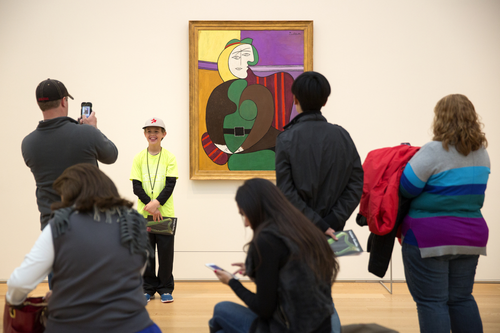 "A young visitor has his photo taken with Pablo Picasso's ""The Red Armchair"" in the Modern Wing of the Art Institute of Chicago Tuesday, April 21, 2015. (Erin Hooley/Chicago Tribune)"