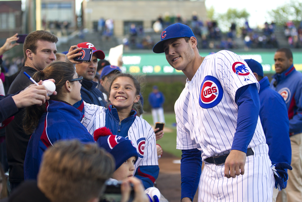 A young fan takes a selfie with Cubs' Anthony Rizzo before the Chicago Cubs game against the New York Mets at Wrigley Field in Chicago Wednesday, May 13, 2015. (Erin Hooley/Chicago Tribune)