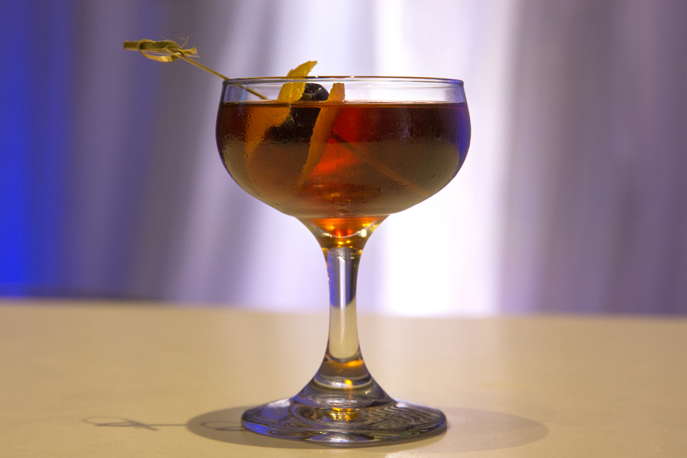O'Leary's Cow cocktail at Staytion Market & Bar inside the Renaissance Chicago Downtown Hotel Tuesday, May 5, 2015. The O'Leary's Cow is Glenlivet 12-Year-Old Scotch, Bulleit Bourbon, Luxardo Maraschino Cherry Liqueur,  Ramazzotti Amaro and bitters, stirred and served straight up or over an ice sphere, garnished with flamed orange peel and maraschino cherry. (Erin Hooley/Chicago Tribune)