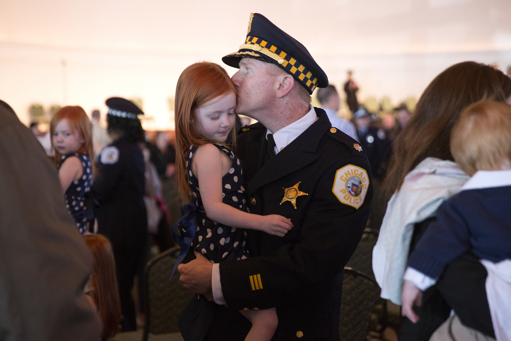 Cmdr. Brendan Deenihan kisses his daughter Claire, 3, after receiving his promotion to Commander at the Chicago Police Department ceremony in the Grand Ballroom at Navy Pier in Chicago Monday, April 27, 2015. (Erin Hooley/Chicago Tribune)