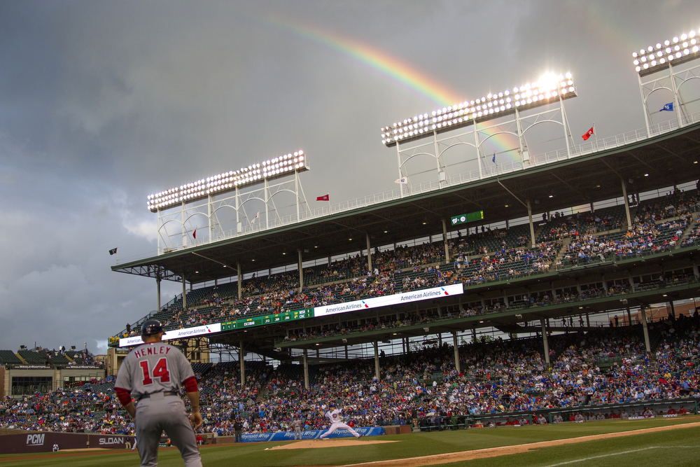 A rainbow appears over Wrigley Field during the third inning of the Chicago Cubs versus Washington Nationals baseball game Tuesday, May 26, 2015. (Erin Hooley/Chicago Tribune)