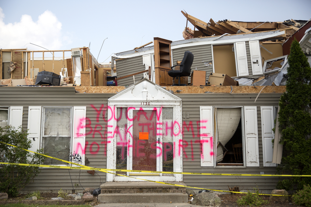 "A house in the Coalfield subdivision damaged by the June 22 tornadoes is spray painted with the words ""You can break the home not the spirit!"" in Coal City, Ill. Tuesday, June 30, 2015. (Erin Hooley/Chicago Tribune)"
