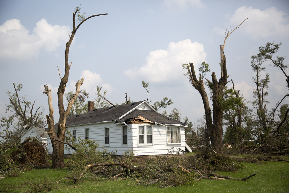 A damaged house and trees from the June 22 tornadoes can be seen on Berta Road in Coal City, Ill. Tuesday, June 30, 2015. (Erin Hooley/Chicago Tribune)