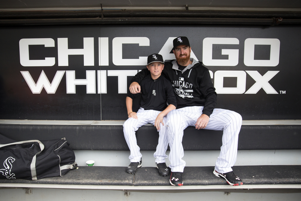 Chicago White Sox designated hitter Adam LaRoche (25) sits with his son Drake, 13, in the White Sox dugout at U.S. Cellular Field before a game against the Houston Astros in Chicago Monday, June 8, 2015. (Erin Hooley/Chicago Tribune)