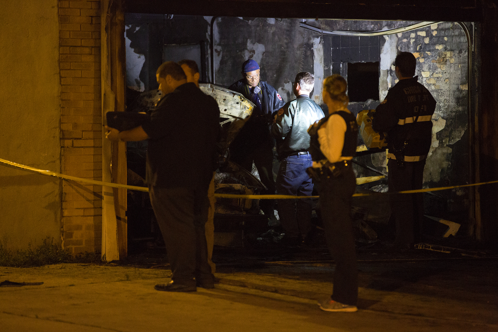 Police and fire officials investigate a garage fire where a body was found in the 6300 block of West Berenice Avenue in the Portage Park neighborhood of Chicago Thursday, July 2, 2015. Firefighters were called to the scene at 8:11 p.m. (Erin Hooley/Chicago Tribune)