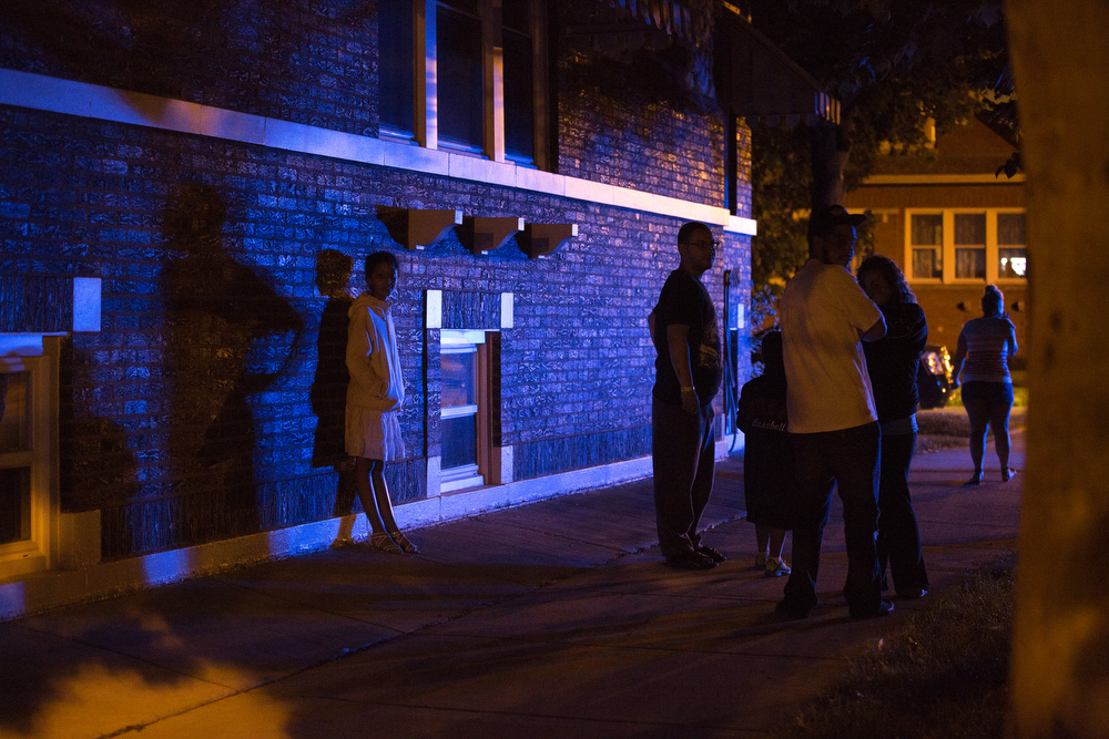 People stand on the sidewalk near the scene of a garage fire where a body was found in the 6300 block of West Berenice Avenue in the Portage Park neighborhood of Chicago Thursday, July 2, 2015. Firefighters were called to the scene at 8:11 p.m. (Erin Hooley/Chicago Tribune)