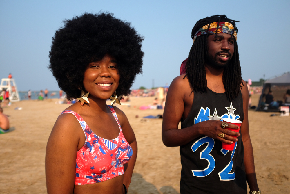 Amara Ogboi and Westley Parker hang out at Montrose Beach in Chicago Saturday, July 4, 2015. (Erin Hooley/Chicago Tribune)