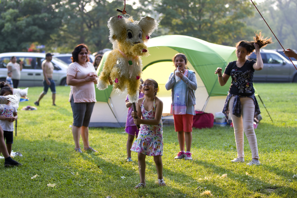 Daniela Reyes, 7, hits a piñata on her birthday near Montrose Beach in Chicago Saturday, July 4, 2015. (Erin Hooley/Chicago Tribune)