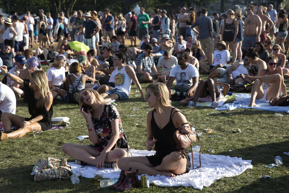 People sit on the grass during the Pitchfork Music Festival in Union Park in Chicago Sunday, July 19, 2015. (Erin Hooley/Chicago Tribune)