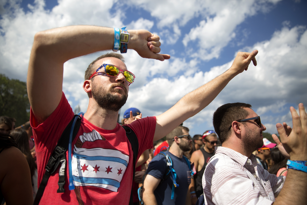 Festival goers dance during CAKED UP's set at the Lollapalooza Music Festival in Grant Park Saturday, August 1, 2015. (Erin Hooley/Chicago Tribune)