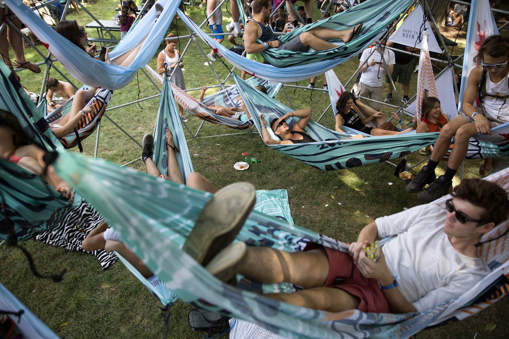 Festival goers relax in hammocks hanging from a large metal structure at the Lollapalooza Music Festival in Grant Park Saturday, August 1, 2015. (Erin Hooley/Chicago Tribune)