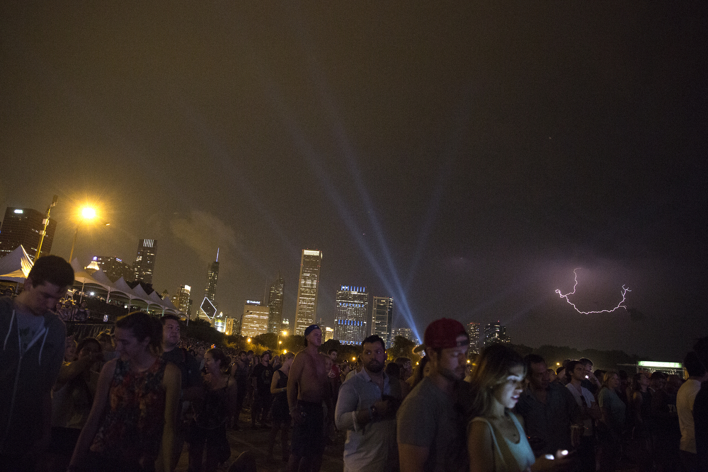 Lightning appears in the sky as fans watch Florence + the Machine perform on the last day of Lollapalooza Music Festival in Grant Park Sunday, August 2, 2015. (Erin Hooley/Chicago Tribune)