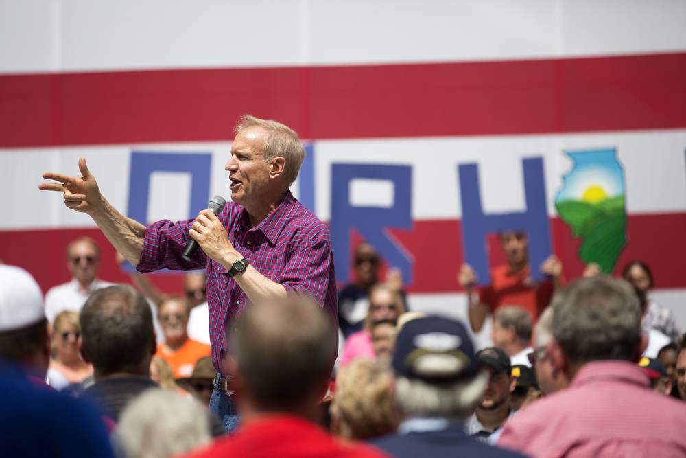 Gov. Bruce Rauner speaks to his supporters during Governor's Day, Wednesday, August 19, 2015 at the Illinois State Fair in Springfield. Republican politicians and party members gathered for a rally on the director's lawn at the state fairgrounds. (Erin Hooley/Chicago Tribune)