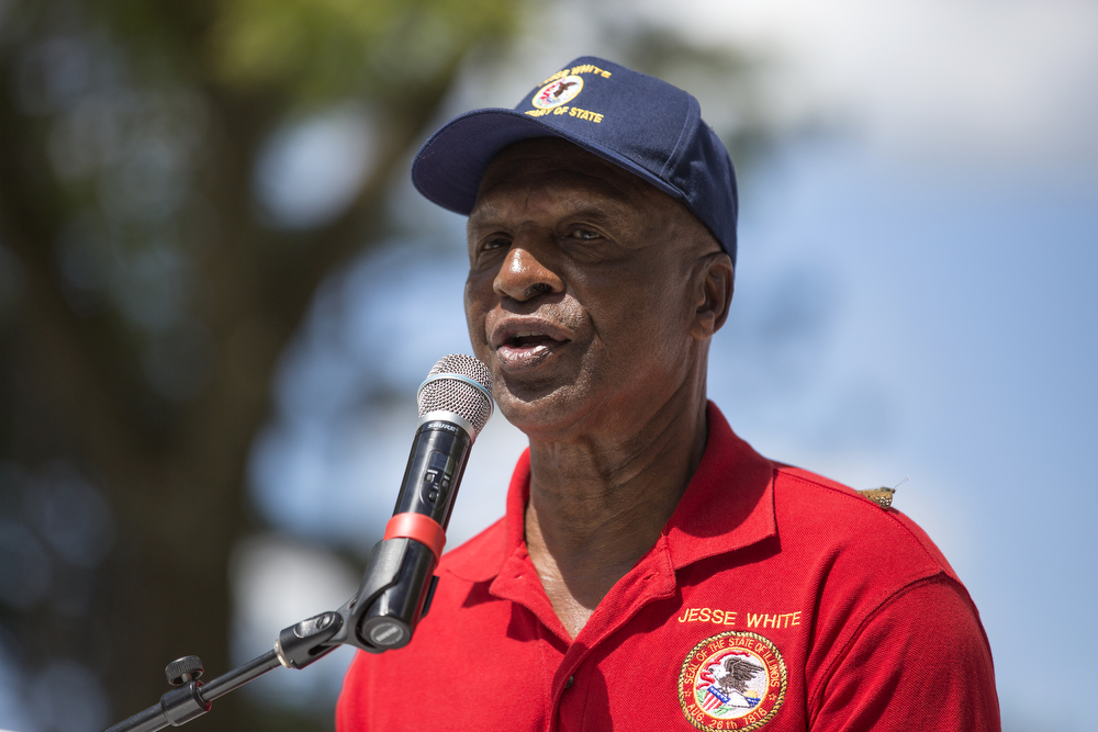 A butterfly sits on the left shoulder of Illinois Secretary of State Jesse White as he gives a speech during Democrat Day on the director's law at the Illinois State Fair Thursday, August 20, 2015 in Springfield. (Erin Hooley/Chicago Tribune)