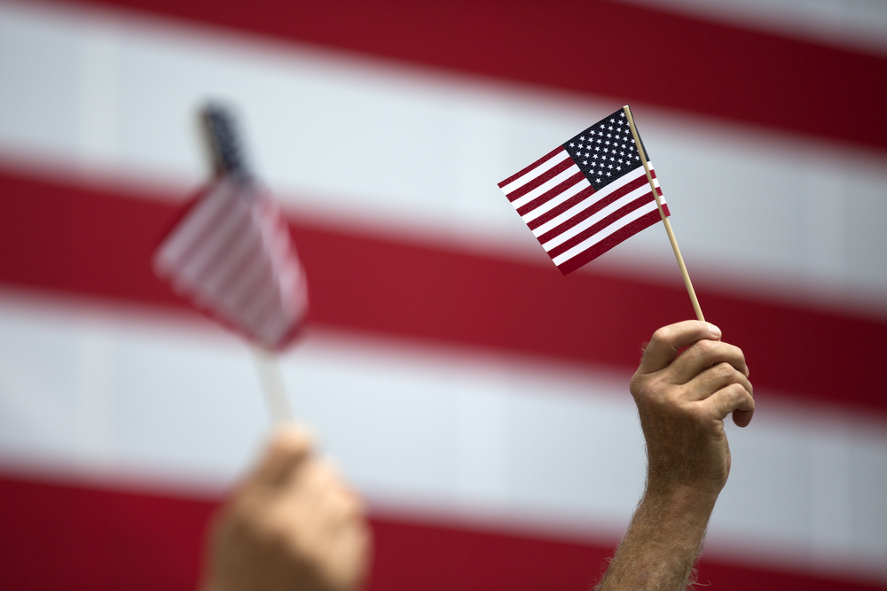 Supporters of the Republican party hold up American flags during Governor's Day, Wednesday, August 19, 2015 at the Illinois State Fair in Springfield. (Erin Hooley/Chicago Tribune)