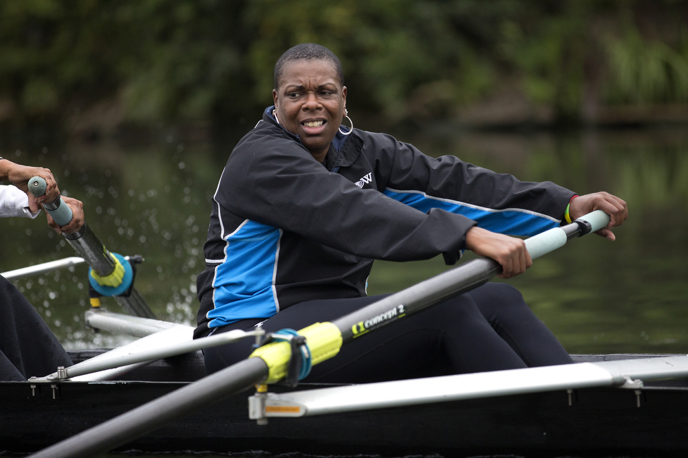 Kym Reynolds rows with other members of the Recovery on Water breast cancer survivors rowing crew during practice on the South Branch of the Chicago River August 26, 2015. (Erin Hooley/Chicago Tribune)