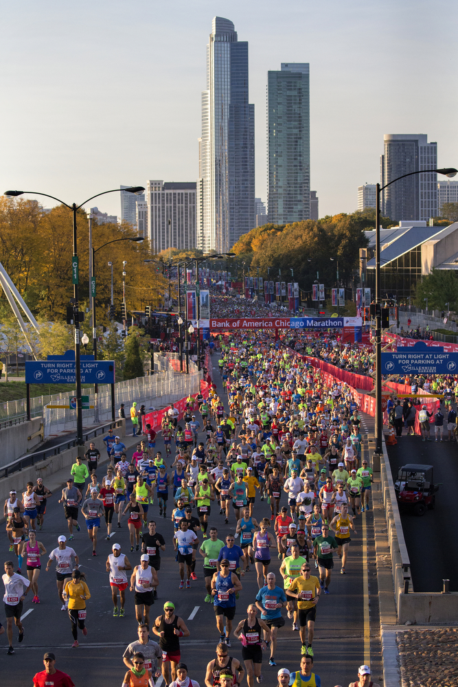 Thousands of runners take off from Monroe Street and head up Columbus Drive for the start of the Bank of America Chicago Marathon Sunday, Oct. 11, 2015 in Chicago. (Erin Hooley/Chicago Tribune)