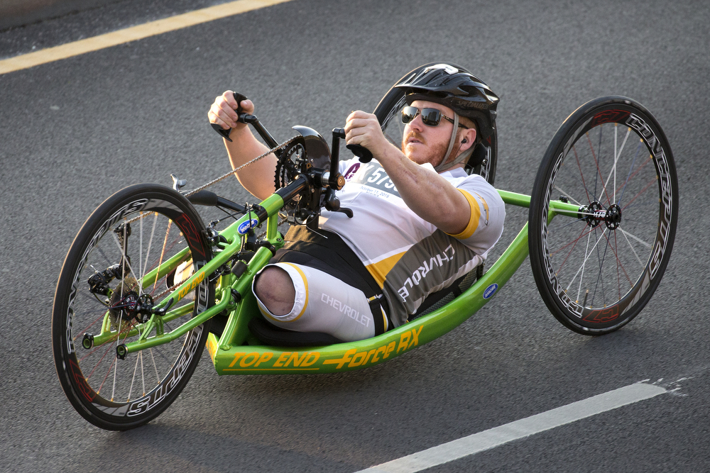 Ben Maenza of the United States makes his way up Columbus Drive during the hand cycle start of the Bank of America Chicago Marathon Sunday, Oct. 11, 2015 in Chicago. Maenza later won first place among the group of hand cyclists. (Erin Hooley/Chicago Tribune)